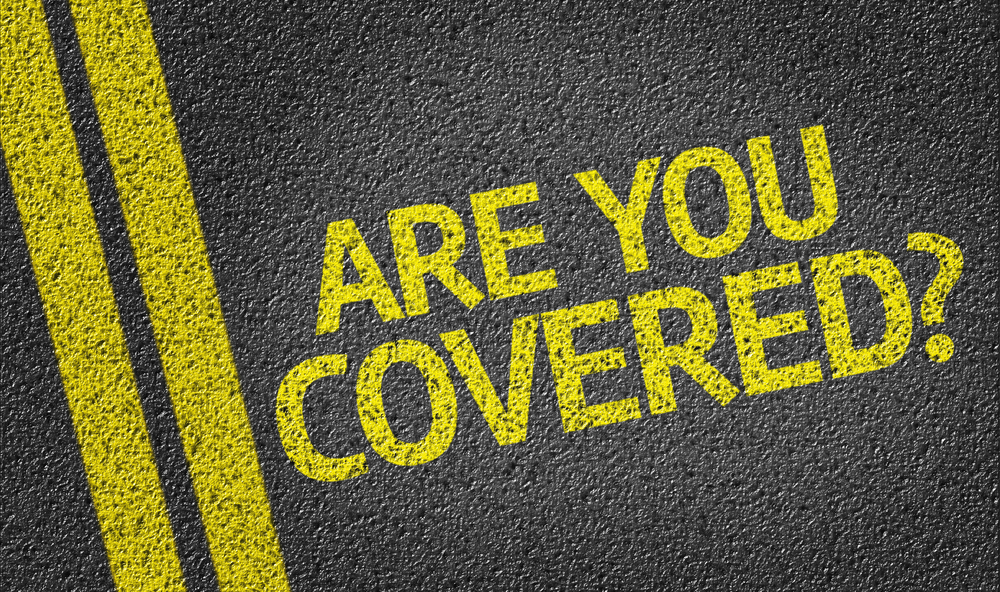 Are you Covered? written on the road